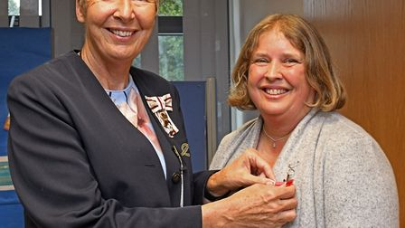 Julie Spence presents the British Empire Medal to Lisa Duffy. Picture: ARCHANT