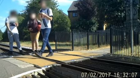 Teenagers misusing the Cottonmill level crossing. Picture: Network Rail CCTV