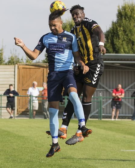 Lewis Irwin gets off the ground during St Neots Town's defeat to Rushall Olympic. Picture: CLAIRE HO