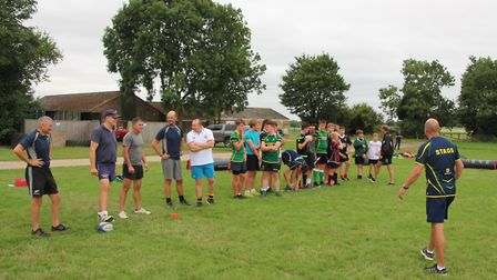 Huntingdon head coach Damien Whales passes on his knowledge to coaches and players from the junior s
