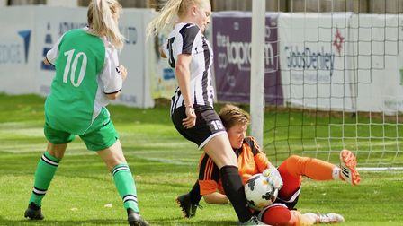 St Ives Town Ladies striker Lauren Gibson is denied a second goal by the Lawford goalkeeper. Picture