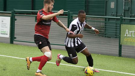 St Ives Town man Munashe Sundire on the ball during their defeat at Redditch. Picture: LOUISE THOMPS