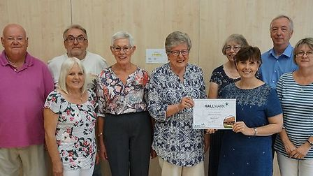 Somersham management committee with Lisa Chambers presenting the certificate to the trustees.