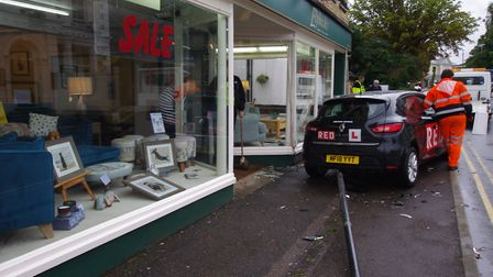 A driving school car collided with the front of Elphicks shop in Huntingdon this morning