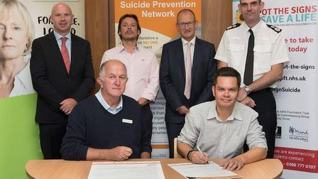 Back left to right: Tom Cahill, Chief Executive of HPFT, Robert Stringer of Hectors House charity, C