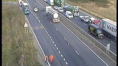 Recovery crews are attepting to remove the bus. Picture: HIGHWAYS ENGLAND