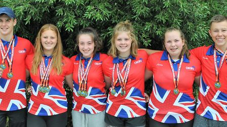 The successful Cambridgeshire Royals and St Neots Dragon Boat Team members show off their European m