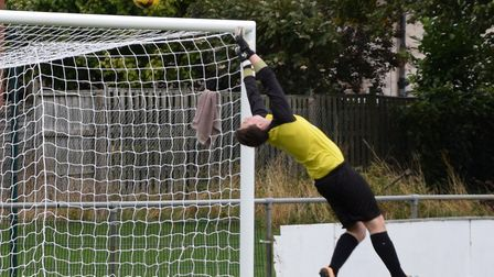 Huntingdon Town goalkeeper Dan Smith makes a fine save during their loss at Blackstones. Picture: MA