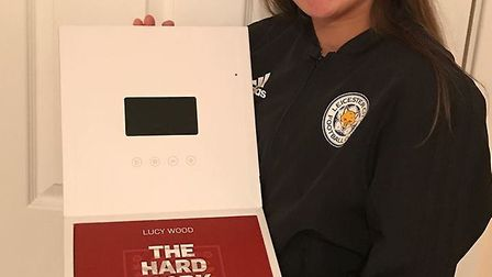 Lucy wood was presented with the box from England that has a coin in it for every year she is invite