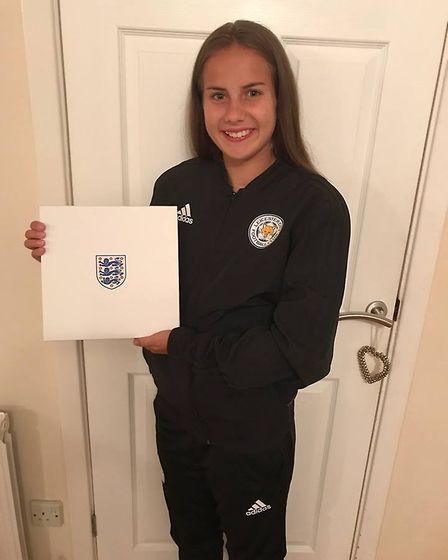 Lucy Wood was sent a box by England which includes a coin for everytime she will train for England