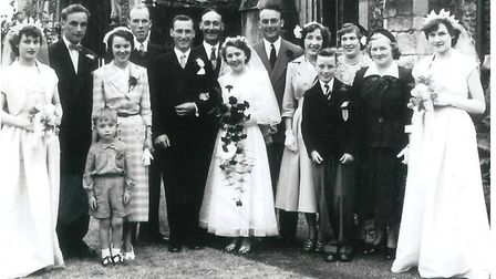 Gladys and Don Scotcher with their family on their wedding day in 1953
