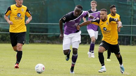Roman Michael-Percil tries to get a grips of David Moyo in full flow. Picture: LEIGH PAGE