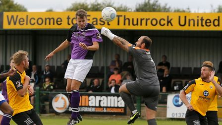 Sam Merson heads past an outstretched Jack Giddens to put the Saints into a first half lead. Picture