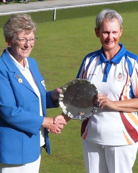 Harpenden Bowls Club's Dena Roberts receives the St Albans & District Ladies Officers Singles trophy
