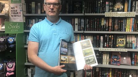 Geoffrey Stalker, shop manager, with the auction booklet