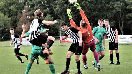 Spencer Clarke-Mardel leaps for the ball during Colney Heath's 2-2 draw with Leverstock Green in the