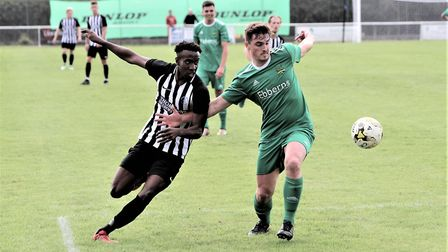 Carl Carr battles for the ball as Colney Heath fought back to draw 2-2 with Leverstock Green in the