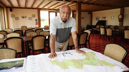 Heydon Grange Golf and Country Club owner John Akhtar looks over his plans for housing development o
