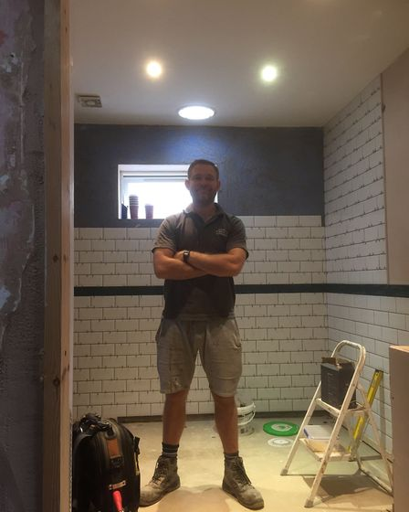 Andy Hill in the new wetroom.