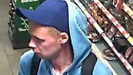 The CCTV picture released by the police following a theft from a BP station in St Albans.