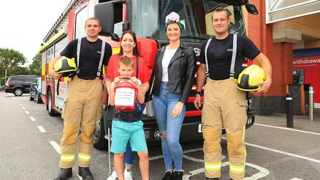 Firefighters Andy Stone and Richard Balsam pose with Lysa's friend and Harriet Wilkinson in front of