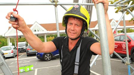 Firefighter Rob shows a total count so far as Royston Firefighters Climb at Tesco for charity 2018.