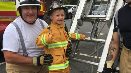 """Louie Hammond, aged 5 - who went to cheer on """"his heroes"""" with dad Craig and was excited to be pictu"""