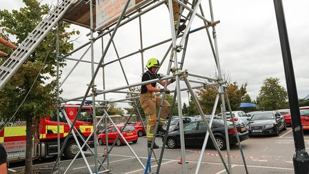 Andy Stone on his way down as Royston Firefighters Climb at Tesco for charity 2018. Picture: KEVIN R