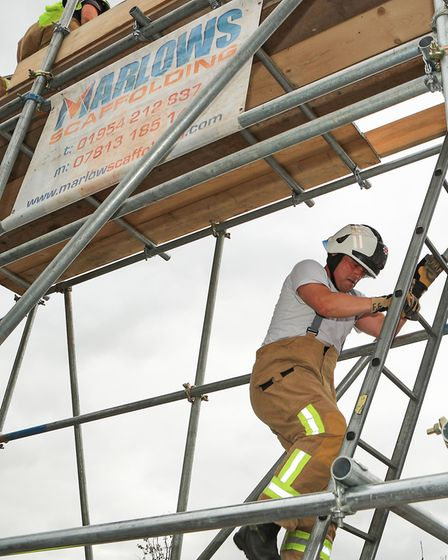 Group Commander Frank Gollogly descends the donated scaffold rig as Royston Firefighters Climb at Te