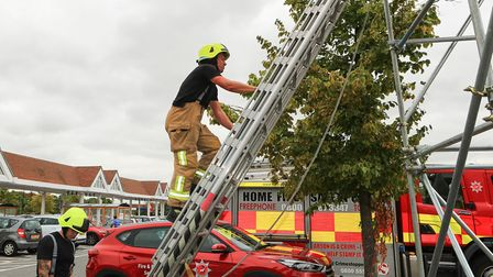 Rob Fortune adds another climb to the total count as Royston Firefighters Climb at Tesco for charity