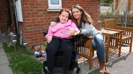 Courtney Copeland, nine who suffers from spinal muscular atrophy type 2 with her mum Julie. Picture: