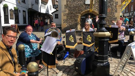 Members of the St Albans City Brass Band busking to attract new players. Picture: Polly Napper.