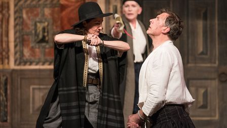 Sarah Finigan as Shylock and Russell Layton as Antonio in The Globe on Tour's Merchant of Venice