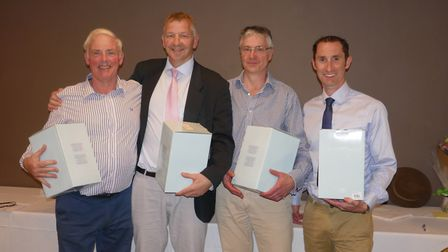 Event organiser Mike Hodge (far left) with members of the winning team at the evening prize giving c