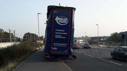 The lorry became wedged under the viaduct after misjudging the height of the structure. Picture: HIG
