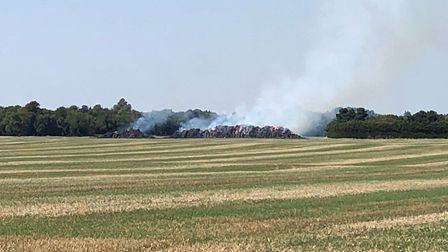 The stack fire between Fowlmere and Foxton started in the early hours of Sunday, and is pictured her