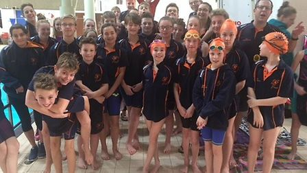 St Ives Swimming Club celebrate the £250 donation. Picture: CONTRIBUTED