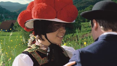 A man and woman in traditional Black Forest dress.