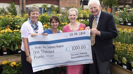 Maggie Philippson receives cheque for 1,000 for the Ayletts prettiest rose competition. Picture: Pau