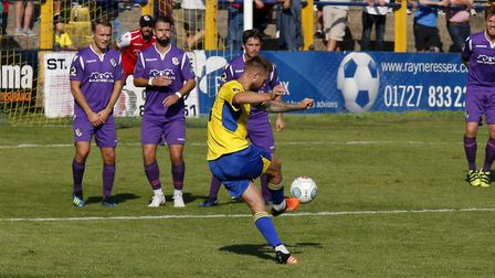 David Noble guides the ball past the Dartford wall. Picture: LEIGH PAGE