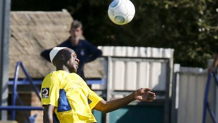 David Moyo powers a header towards the Dartford goal. Picture: LEIGH PAGE