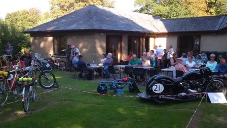 Visitors and exhibitors enjoying teas among some of the two-wheeled exhibits.Picture: John Price
