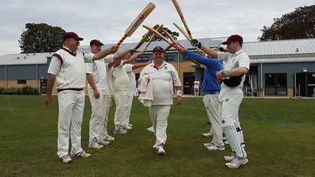 Phil Wanstall is given a guard of honour by his Abbots Ripton team-mates ahead of his final appearan