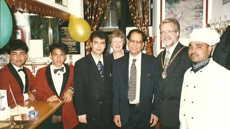 The founder and proprietor Nazir Choudhury with his team, including Siraj, and the mayor at the time