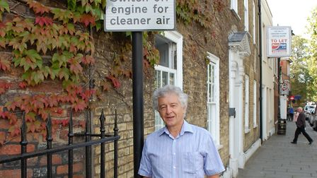 Cllr Rowlands at an anti-idling sign at St Peter's Street, St Albans.