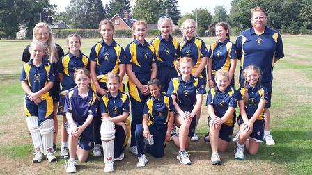 The Hunts Under 13 Girls squad pictured with coach Tom Milner.