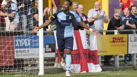 Nabil Shariff celebrates in front of the travelling St Neots Town supporters at Banbury. Picture: CL