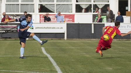Dylan Williams hits St Neots Town's third goal in their victory at Banbury. Picture: CLAIRE HOWES