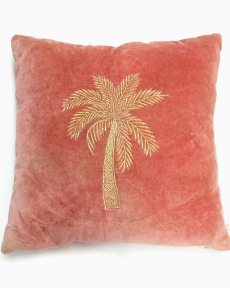 Keep the Summer Vibe Alive: Embroidered Velvet Palm Tree Cushion, £46, Audenza. Picture: Audenza/PA