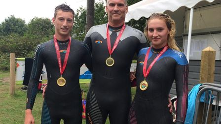 Simon Bradford (centre) with son Jordan (left) and daughter Nicole (right) at the Fritton Open Water